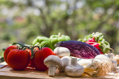 Fresh vegetables on wooden chopping board Stock Image