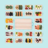 Fresh vegetables and wooden chopping board. Fresh raw healthy vegetables on wooden chopping boards frame and copy space at center, healthy eating concept Royalty Free Stock Photos