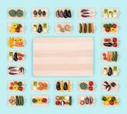 Fresh vegetables and wooden chopping board. Fresh raw healthy vegetables on wooden chopping boards frame and copy space at center, healthy eating concept Stock Photo
