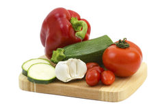 Fresh vegetables on a wooden cutting board Royalty Free Stock Images