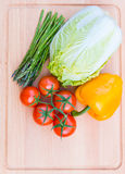 Fresh vegetables on wooden cutting board, healthy food. Royalty Free Stock Photo