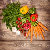 Fresh vegetables on a wooden table Stock Image
