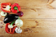 Fresh vegetables on wooden table from above Stock Photo