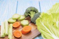 Fresh vegetables on a wooden table. The concept of healthy eating. Vegan, vegetarian.  Royalty Free Stock Photos