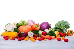 Fresh vegetables on wooden table. Isolated. Fresh vegetables on wooden table. Isolated on white background Stock Image