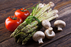 Fresh vegetables on a wooden table Stock Images