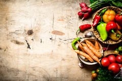Fresh vegetables on wooden table. Organic vegetables. Fresh vegetables on a wooden table Stock Photo