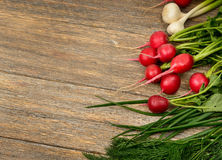 Fresh vegetables on wooden table. Stock Photo