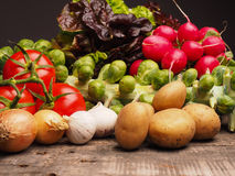Fresh vegetables on a wooden table Stock Photos