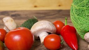 Fresh vegetables on wooden table stock footage