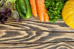 Fresh vegetables on a wooden table. Top view Royalty Free Stock Image
