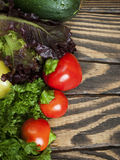 Fresh vegetables on a wooden table. Top view Stock Photos
