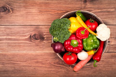 Fresh vegetables on the wooden tray on the rustic background. Stock Photography