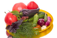Fresh vegetables on a yellow plate Stock Photo