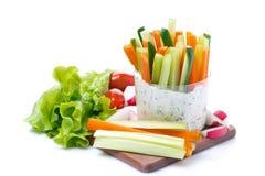Fresh vegetables with yogurt sauce, isolated Royalty Free Stock Image