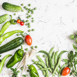Fresh vegetables - zucchini, cucumbers, green peas and beans, parsnips, peppers, tomatoes, onions on a white background. Concept of a healthy, diet food Royalty Free Stock Photography