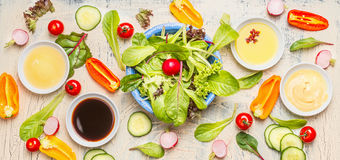Fresh vegetarian salad with delicious vegetables ingredients,dressings and lettuce leaves for healthy eating or diet royalty free stock photo