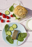 Fresh vegetarian sandwich roll with lentil pâté, yellow cheese royalty free stock image