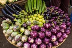 Fresh veggie basket from the Colaba Market farmer`s market: onions, aubergines, scallions, shallots, lady`s fingers stock photo