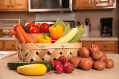 Fresh vegitables on the kitchen cabinet. Fresh tomatoes, peppers carrots, cucumber, corn radish and squash on the kitchen cabinet royalty free stock image