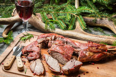 Fresh venison around with antlers and spruce Royalty Free Stock Images