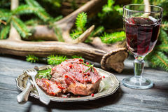 Fresh venison on a plate and red wine Royalty Free Stock Image