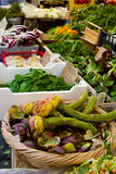 Fresh vernal artichokes with greens and vegetables on the market Campo dei Fiori, Rome Stock Image