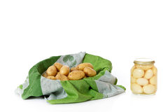 Fresh versus canned potatoes Royalty Free Stock Image