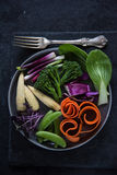Fresh vibrant vegetables on plate Royalty Free Stock Images