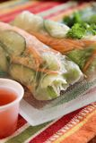 Asian vegetable rolls in rice paper with spicy sauce for dippin royalty free stock photography