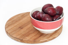 Fresh violet plums in the bowl Royalty Free Stock Images
