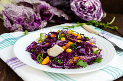 Fresh vitamin fitness salad of red cabbage, bell peppers, corn, arugula. Stock Photo