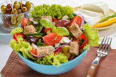 Fresh vitaminic green salad with bread cubes Royalty Free Stock Photos