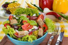 Fresh vitaminic green salad with bread cubes Royalty Free Stock Photo