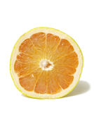 Fresh Vitamins. Frontal view of a sliced grapefruit on white background royalty free stock images