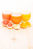 Fresh vitamins juice with different pieces of fruits Stock Photos