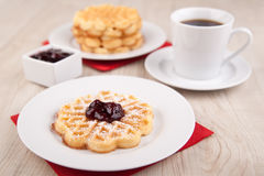 Fresh waffle with sugar powder and cherry sauc Royalty Free Stock Photo