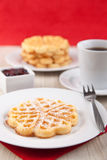 Fresh waffle with sugar powder and cherry sauce Stock Images
