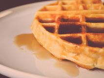Fresh waffle with sweet syrup in white plate. Royalty Free Stock Photo