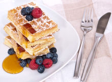 Fresh waffles with fruits and sirup Stock Photo