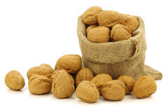 Fresh walnuts in a burlap bag Stock Image