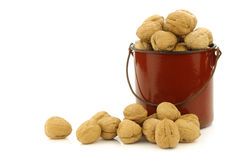 Fresh walnuts in an enamel  cooking pot Stock Photo