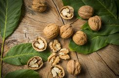 Walnuts. Fresh walnuts on an old wooden table Royalty Free Stock Photography