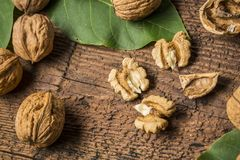 Walnuts. Fresh walnuts on an old wooden table Stock Photos