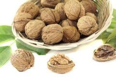 Fresh walnuts with walnut leaves in a basket Stock Photo