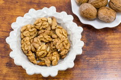 Fresh walnuts in a white bowl Royalty Free Stock Images