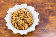 Fresh walnuts in a white bowl Stock Photos