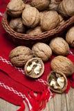 Fresh walnuts in wicker basket Royalty Free Stock Photography