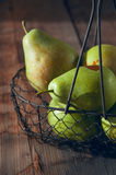 Fresh washed pears in a basket Stock Photos