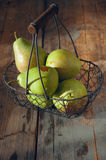 Fresh washed pears in a basket Royalty Free Stock Image